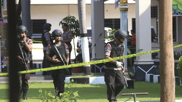 Police at the scene of a suicide bombing in Solo, Indonesia, which the authorities believe was carried out by a militant network (AP)