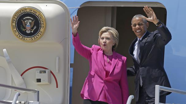 Democratic presidential candidate Hillary Clinton and President Barack Obama wave as they come off Air Force One upon their arrival at Charlotte for a campaign rally (AP)