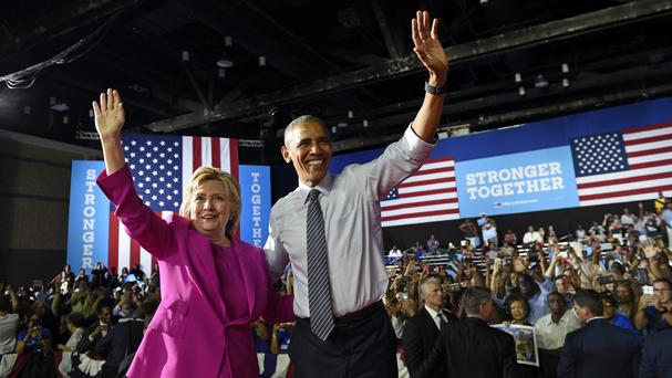 Barack Obama and Hillary Clinton at a campaign event at the Charlotte Convention Centre in North Carolina (AP)