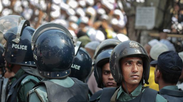 Police in Bangladesh have questioned family members of attackers who stormed a restaurant and killed officers and hostages (AP)
