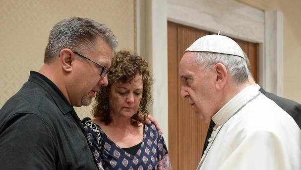 Pope Francis meets Nick, left, and Jodi Solomon, the parents of Beau Solomon, a US college student whose body was found in Rome's Tiber river this week (L'Osservatore Romano/Pool photo via AP)