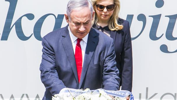 Benjamin Netanyahu, with his wife Sara, laid a wreath at the memorial to victims of the 1994 Rwandan genocide (AP)