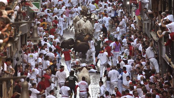 Revellers during the first running of the bulls at the San Fermin festival (AP)