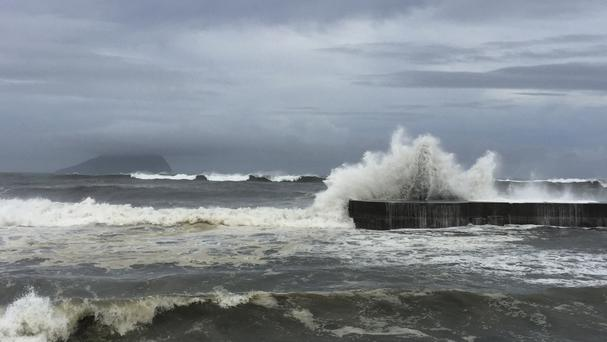 Large waves crash against the eastern coast of Taiwan as the fast-moving Typhoon Nepartak makes its way across the Philippines Sea (AP)