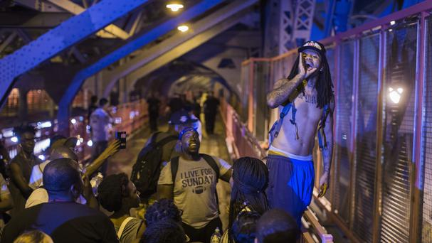 Protesters march across Williamsburg bridge in New York following the police shootings in Louisiana and Minnesota (AP)