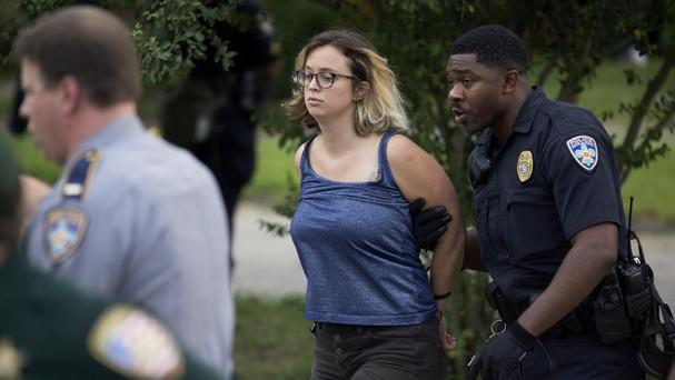 Police arrest protesters after dispersing crowds in a residential neighbourhood in Baton Rouge (AP)