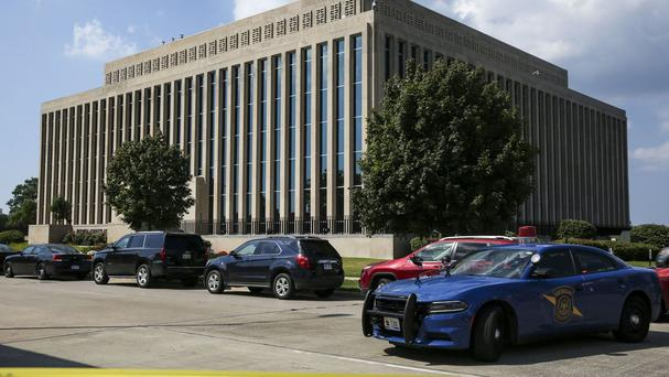 Police tape surrounds the Berrien County Court building (Chelsea Purgahn/Kalamazoo Gazette via AP)