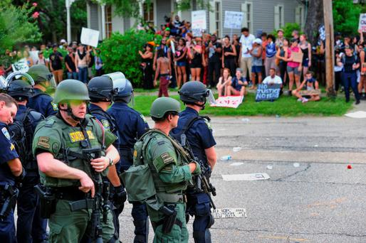 Police officers keep a close eye on protesters gathering in Baton Rouge, Louisiana. Photo: Scott Clause/AP