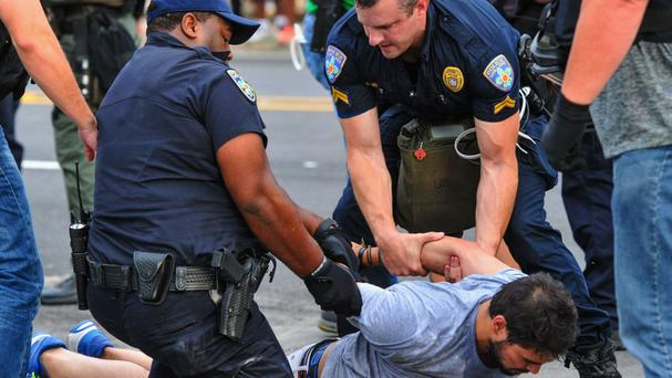 Police detain a protester in Baton Rouge (Scott Clause/The Daily Advertiser/AP)