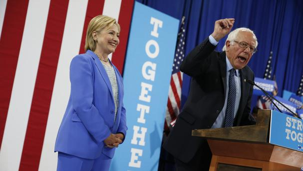 Bernie Sanders backs Mrs Clinton for the White House (AP)