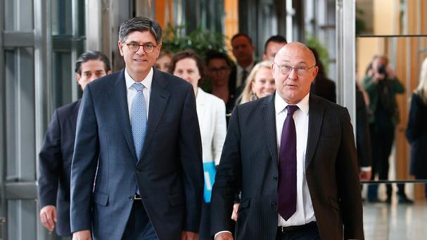 US treasury secretary Jacob Lew, left, and France's Michel Sapin arrive at the finance ministry, in Paris (AP)