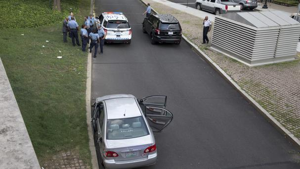 Police gather in front of a car with its doors open near the US Capitol in Washington (AP)
