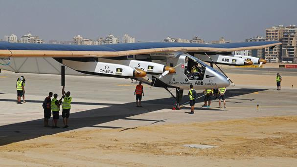 The experimental solar-powered plane landed in Cairo, Egypt (AP)