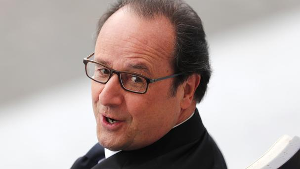French president Francois Hollande looks on during the Bastille Day parade in Paris (AP)