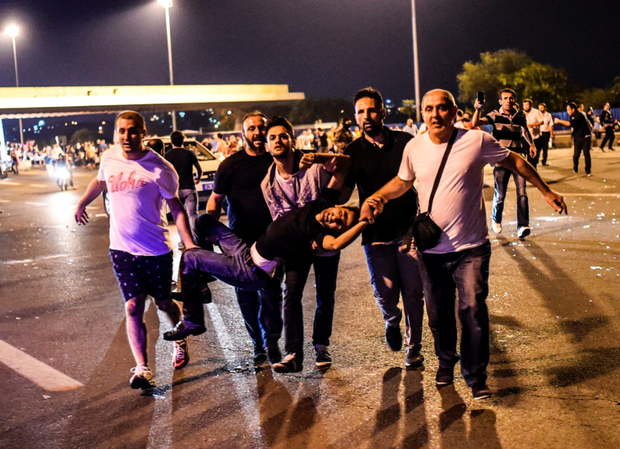 A man is carried from the Bosphoros Bridge after being shot. Photo: PA Getty