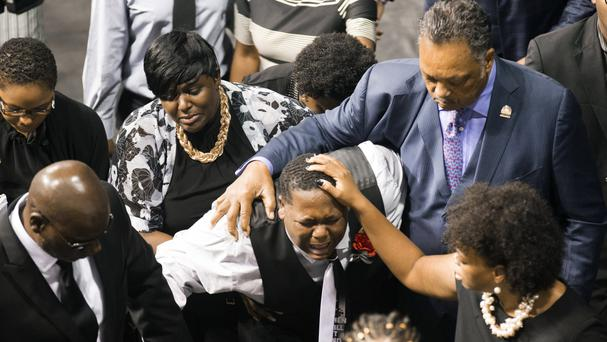 Alton Sterling's son Cameron, 15, is consoled by the Rev Jesse Jackson and a family member during his father's funeral at Southern University in Baton Rouge (The Daily Advertiser/AP)