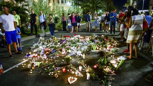 Tributes are placed where bodies fell on the Promenade des Anglais