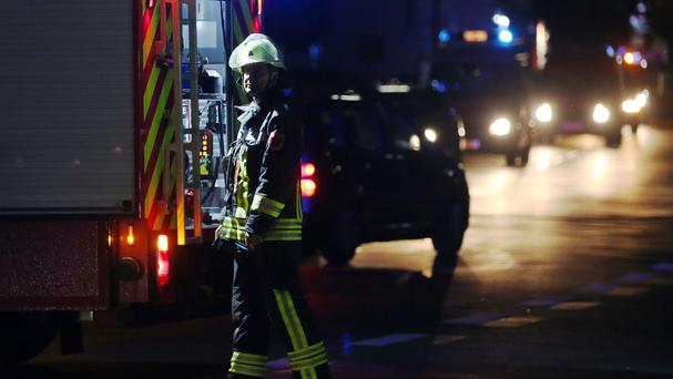 A firefighter stands at a road block in Wuerzburg, southern Germany, after a man attacked people on a train (dpa/AP)