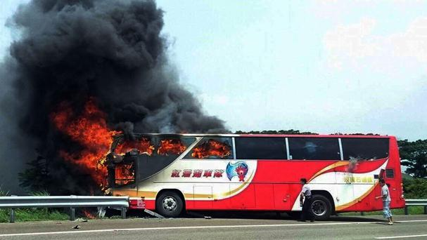 A tour bus caught fire on a motorway in Taoyuan, Taiwan (Yan Cheng/Scoop Commune via AP)