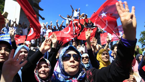Pro-government supporters protest against the attempted coup in Istanbul (AP)