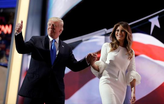 Republican candidate Donald Trump walks off the stage with his wife Melania during the Republican National Convention. Photo: John Locher/AP