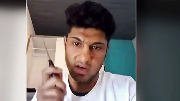 A video which purports to show a 17-year-old Afghan asylum seeker who attacked people with an axe and knife on a train in southern Germany (AP)