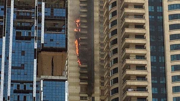 The fire broke out in the Sulafa Tower in Dubai's Marine district (AP)