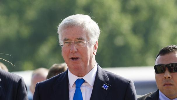 Michael Fallon arrives at the meeting of countries fighting IS (AP)