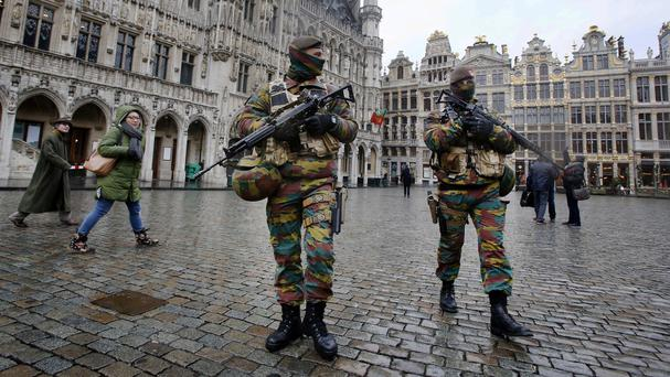 Security is tight across Belgian as the country marks a national holiday (AP)