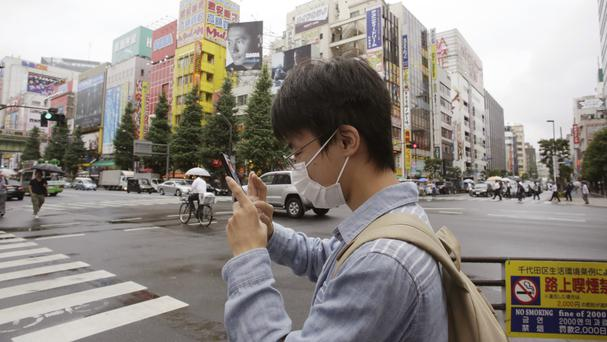 A man plays Pokemon Go in Tokyo's Akihabara district (AP)