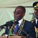 President Robert Mugabe speaks at Zimbabwe's 36th Independence day celebrations in Harare in April (AP)