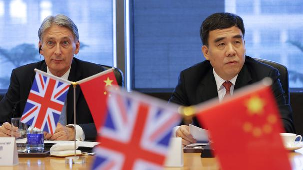 Chancellor Philip Hammond with Bank of China chairman Tian Guoli in Beijing (Damir Sagolj/Pool/AP)
