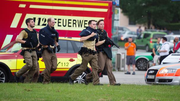 Policemen arrive at a shopping centre in which a shooting was reported in Munich, southern Germany (Matthias Balk/dpa via AP)