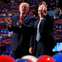Donald Trump and vice presidential nominee Governor Mike Pence (right) onstage at the end of the final session of the Republican National Convention in Cleveland, Ohio, on Thursday night Photo: Aaron P Bernstein/Reuters