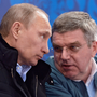 Vladimir Putin, left, with IOC boss Thomas Bach in 2014