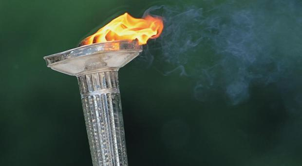 The incident happened as Olympic torch passed through the Brazilian town of Guarulhos