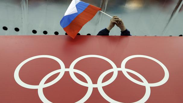 IOC officials have decided against a complete ban for Russia from this summer's Olympic Games (AP)