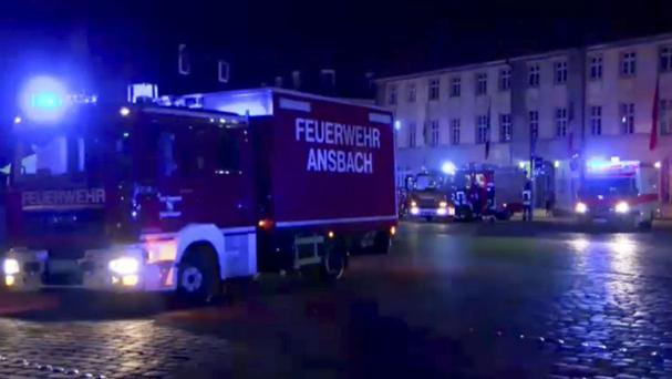 In this image taken from video fire trucks and ambulances stand in the city centre of Ansbach after a man was killed in an explosion (News5/AP)