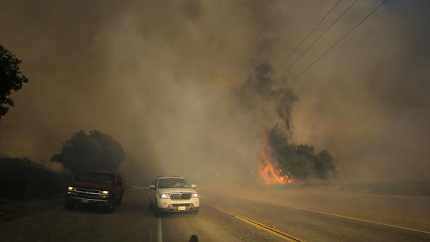 A wildfire burns along the Placenta Canyon Road in Santa Clarita, California (AP)