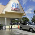 An investigator walks near the scene of a fatal shooting at Club Blu nightclub in Fort Myers (Kinfay Moroti/The News-Press via AP)