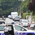 French police prevent access to the scene of the attack in Saint Etienne du Rouvray, Normandy,in which an 84-year-old priest was killed when his throat was slit (AP Photo/Francois Mori)