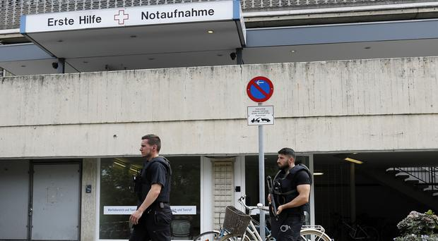 Armed police at the Benjamin-Franklin Hospital in Berlin where a patient shot a doctor and killed himself (AP Photo/Michael Sohn)