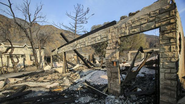A burned home near Iron Canyon Road in Santa Clarita, California after a wildfire forced thousands from their homes (AP Photo/Ringo H.W. Chiu)