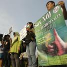 Protesters attend a rally against the death penalty outside the presidential palace in Jakarta (AP Photo/Achmad Ibrahim)
