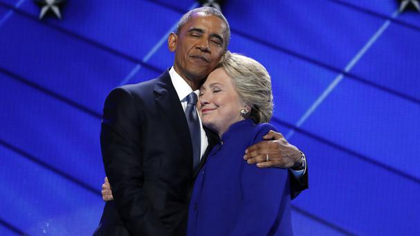 US president Barack Obama hugs Hillary Clinton after addressing delegates during the third day session of the Democratic National Convention in Philadelphia (AP)