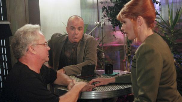 Jerry Doyle, centre, has died aged 60 (AP)
