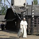 Pope Francis walks through the gate of the former Nazi death camp at Auschwitz (AP)