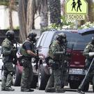 Emergency services near the scene of the shooting in San Diego (San Diego Union-Tribune/AP)