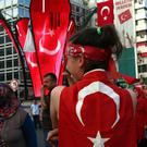 People with Turkish flags gather at the 15 July martyrs square in Ankara, Turkey (AP)