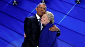 HAPPY FAMILIES: Barack Obama hugs Hillary Clinton at the Democratic National Convention in Philadelphia last week. Photo: Carolyn Kaster/AP